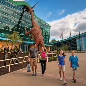 Family outside Dino Room, Children's Museum of Indianopolis
